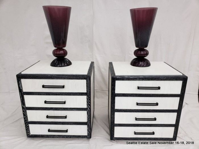 Two-tone, black and white cerused wood dresser with graduated drawers.