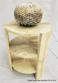 Three-level side table with marble-look finish. Aggregate ombre-look vase.