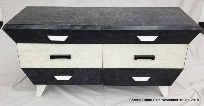 Four drawer side table in black and white cerused wood.
