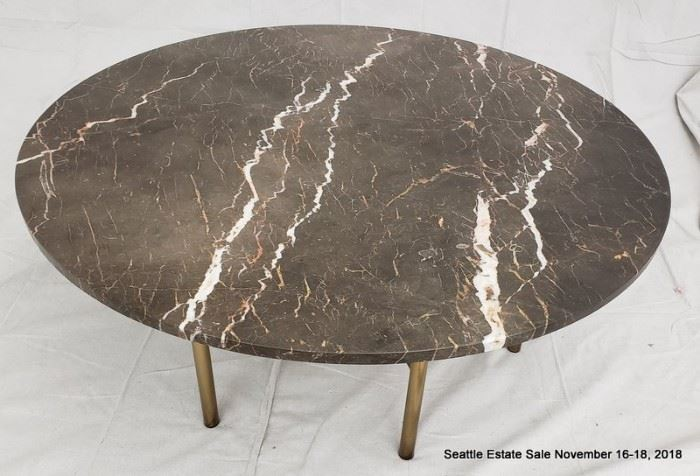 Large round patinated bronze and crackled glass coffee table.