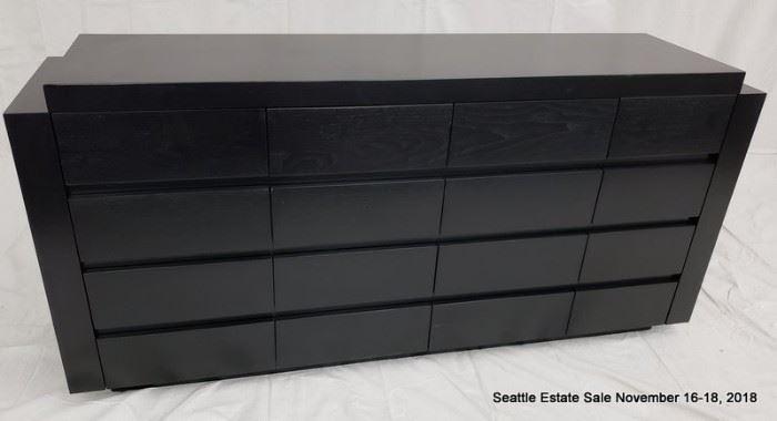 16-Drawer credenza with textured ebonized cerused wood finish.