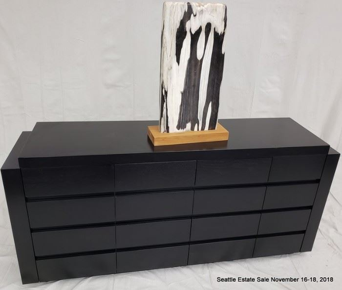 16-Drawer credenza with textured ebonized cerused wood finish.  Black and white striated stone accent sculpture.