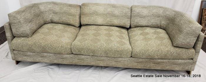 Bronze-framed upholstered sofa.
