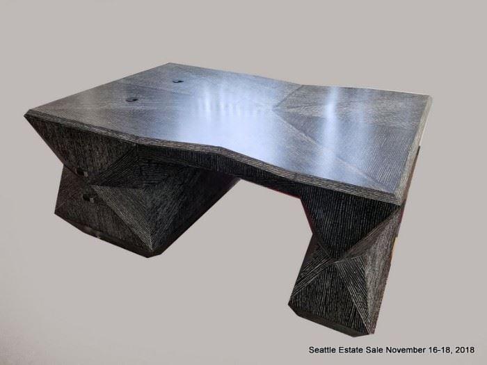 Angular black and white patterned cerused wood finish partners desk.