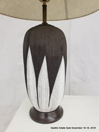 Two-tone ceramic lamp with white shade.