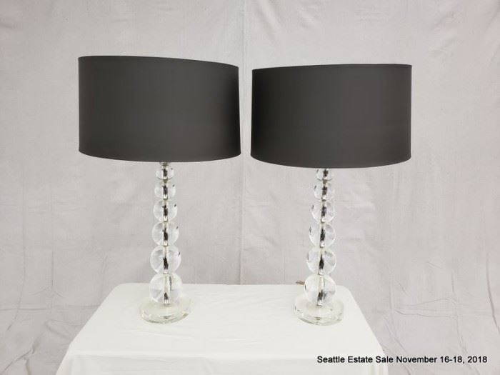 Table lamp with graduated ball design.