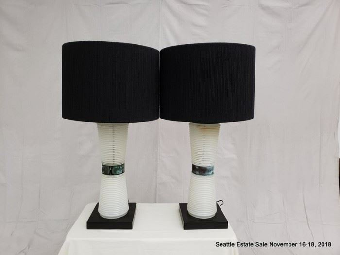 Table lamp with concentric graduated bases and patinated collar.