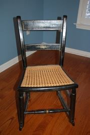 Vintage black child's rocker/weaved seat