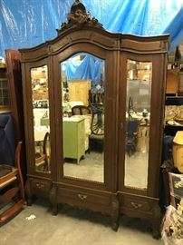 French Armoire, Beveled mirred doors, this is a break down that comes apart in pieces and goes back together like a glove. 3 drawers for extra storage, solid walnut