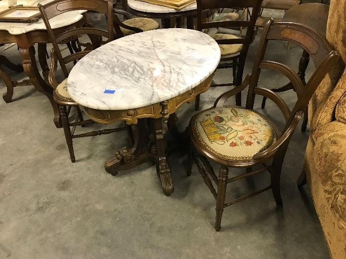Oval Marble top walnut table