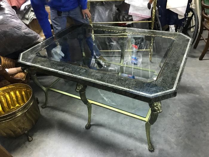 Designer Table with Heavt brass lions head legs,a large coffee table