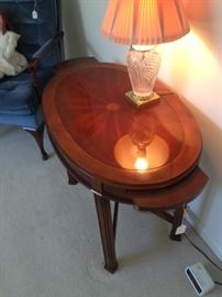 Beautiful dark inlaid round burled wood with pull out shelf for drinks on both sides