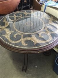 Inlaid travertine tile table with iron base