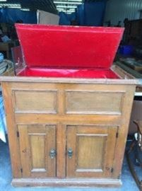 Early pritimive ice box, with original shelves in the bottom behind the doors . lots of storage