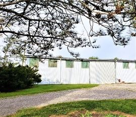 Have you ever wanted more space for storage of vehicles, boats, trailers or lawn equipment? This Aluminum siding pole barn could be all yours. This barn is 75' x 35' with 3 sliding doors, several windows and electricity. This barn has already been moved once to reside on this property over the last several decades. The poles are in the ground and will need to be cut for removal. This barn could use some mending in the roof but likely has many years left. Buyer will be responsible for tearing down and removal of the barn. Barn removal can be arranged with the seller and does not have to be picked up the night if the auction pickup. Buyer will need to be insured and covered for the removal of the barn. Neither the seller nor Candoo will be held responsible for any harm or damage caused during the barn removal. Please contact Erin Maccabee at 614-636-1119 to set up a special preview time if you are interested.