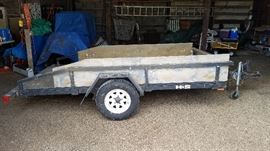 H&S presents a single axle, 10' Roadmaster ATV or utility trailer. The tires are in nice condition and this trailer has a 1000 lb capacity a ton of life left.