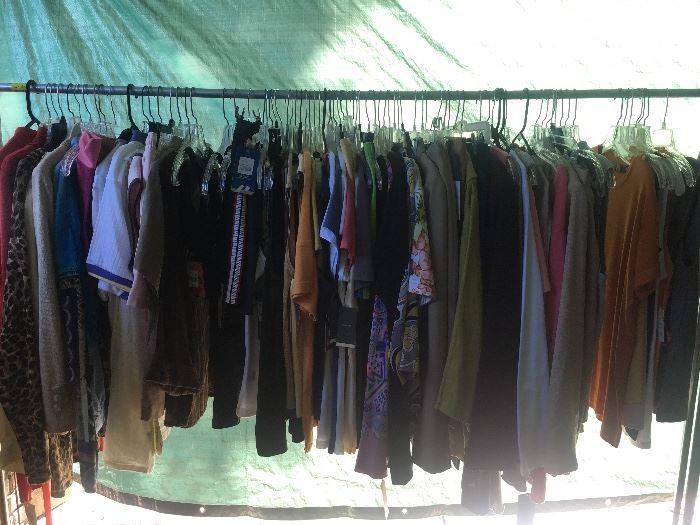 Three racks full of new clothing, 95% still have tags.