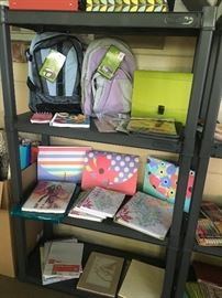 Two shelving units full of new office/school supplies.