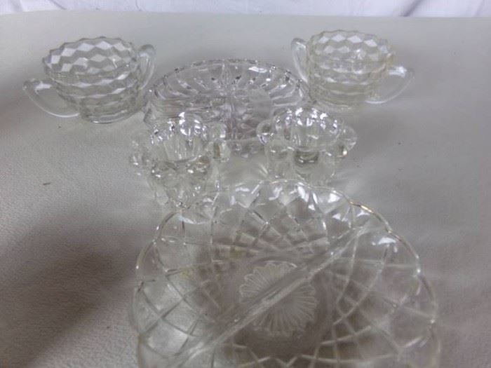 2 relish plates two glass mugs and two glass candl ...