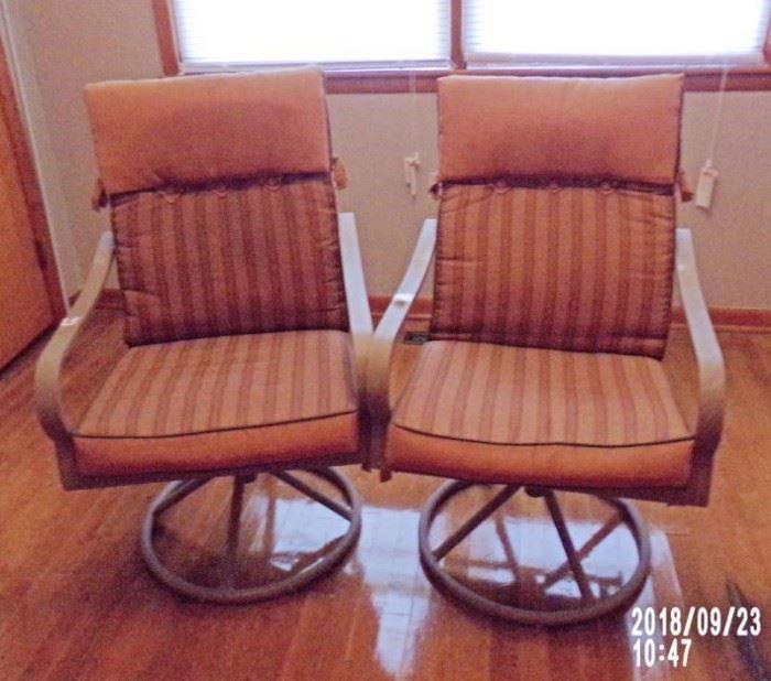 2 patio swivel chairs