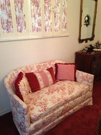 Red and white Toile loveseat; coordinating pillows
