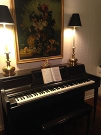 Wurlitzer piano; candlestick lamps with black shades