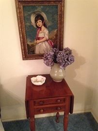 Needlepoint art of a young girl; small side table
