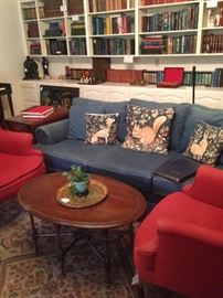 Another blue sofa; pair of red wing back chairs