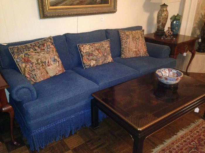 Blue 3-cushion sofa; Asian coffee table
