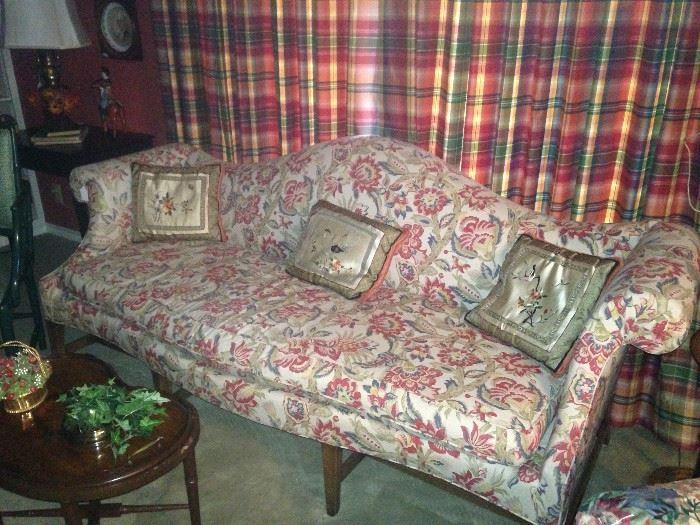 Classic camel back sofa; Asian silk pillows