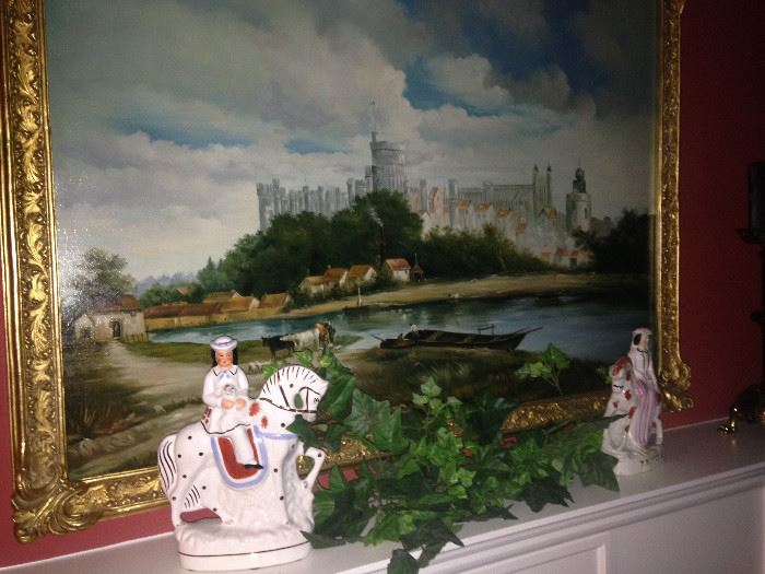 Framed art of a European castle;  eye-catching male and female figurines