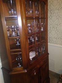 This lovely china cabinet provides display and storage spaces.