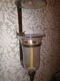 One of two brass sconces