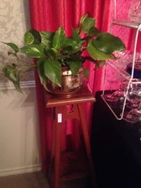 One of two plant stands and brass planter with ivy