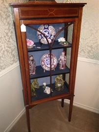 Handsome curio cabinet with Asian selections