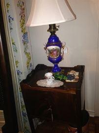 Cobalt blue urn lamp; small antique side table