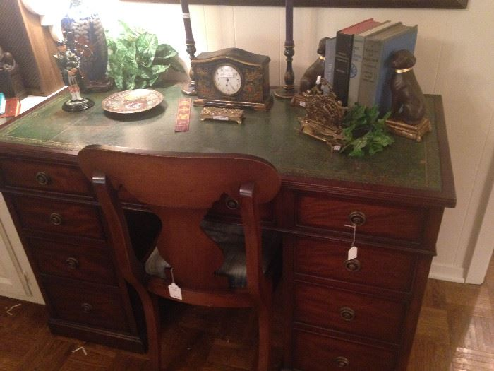 Fine looking green leather top desk (7 drawers)