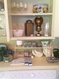 Variety of napkins, candles, glassware, and brass