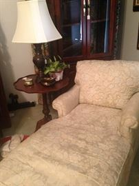 Upholstered chaise lounge; antique pie crust side table