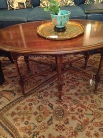 Oval coffee table with cross bar support
