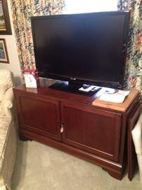 Great TV stand and Sharp flatscreen TV