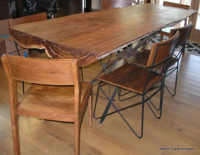 Absolutely Fabulous cypress Slab Table made in Apalachicola , metal base, 6 chairs and is just magnificent, will get measurements added soon.  This Slab is from a log found in the Apalachicola River, many years ago. The Table measures 8 feet by 36 inches.