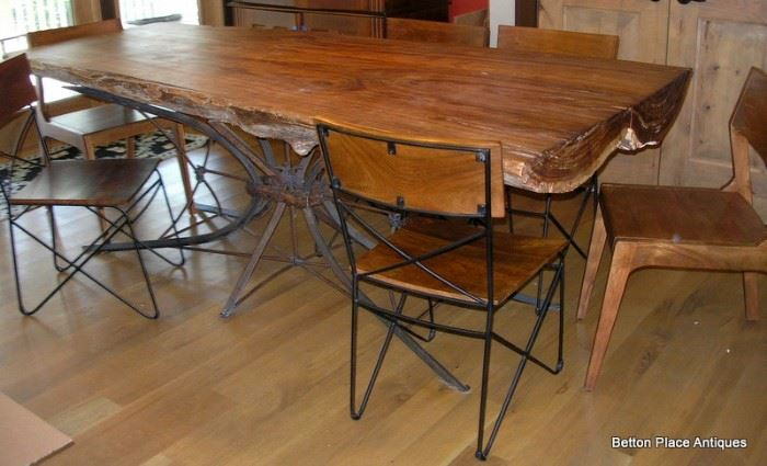 Absolutely Fabulous Cypress Slab Table made in Apalachicola , metal base, 6 chairs and is just magnificent, will get measurements added soon.  This Slab is from a log found in the Apalachicola River, many years ago.