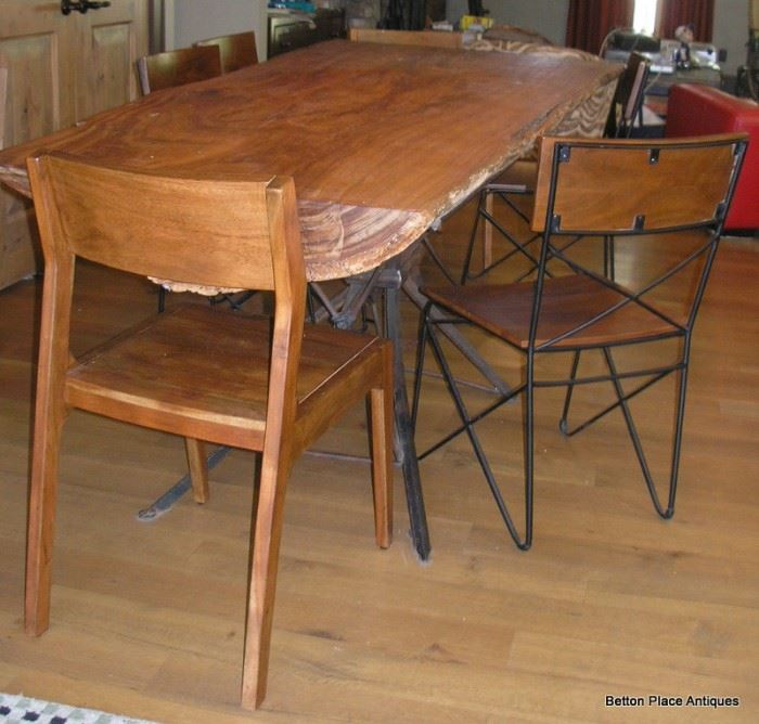 Absolutely Fabulous Slab Table made in Apalachicola , metal base, 6 chairs and is just magnificent, will get measurements added soon.  This Slab is from a log found in the Apalachicola River, many years ago.