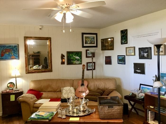 Living room with art, Spanish guitar, leather couch