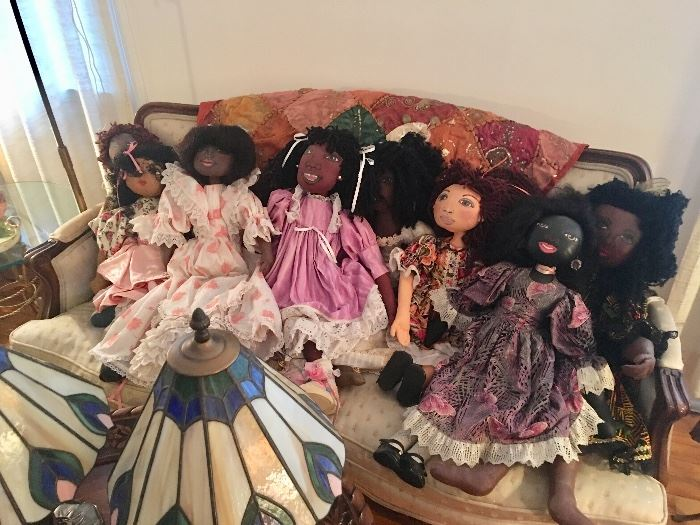 A whimsical assortment of hand made dolls