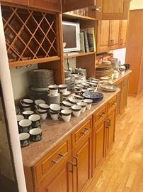 The kitchen is filled with multiple sets of china, crystal (including Riedel), glass, porcelain, pottery, and more