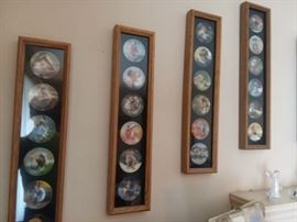 Small collectible plates, framed