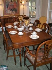 "Dining Room:  The table is set for company!  The  vintage dining table and six chairs are priced as a set.  The table measures 42"" wide  x 62"" long and has three 11"" leaves.   Closer photos of the table legs, one of the chairs, and the table setting follow."