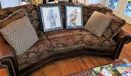 Leather/Fabric nail head sofa, pillows, framed Dallas Cowboy prints